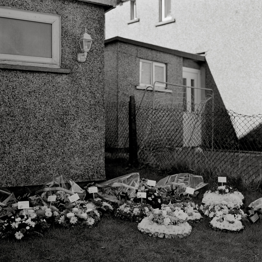 "Floral tributes to the late miner Joseph ""Glamo"" Evans lay in the yard of his house in Maerdy, Rhonddha Valleys, prior to his funeral."