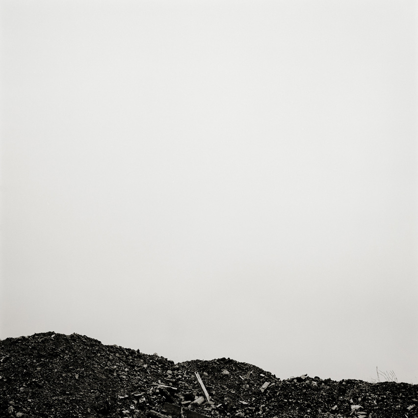 Remains of coal at the top of a slag heap, called Coity Tip, near Blaenavon, Wales.
