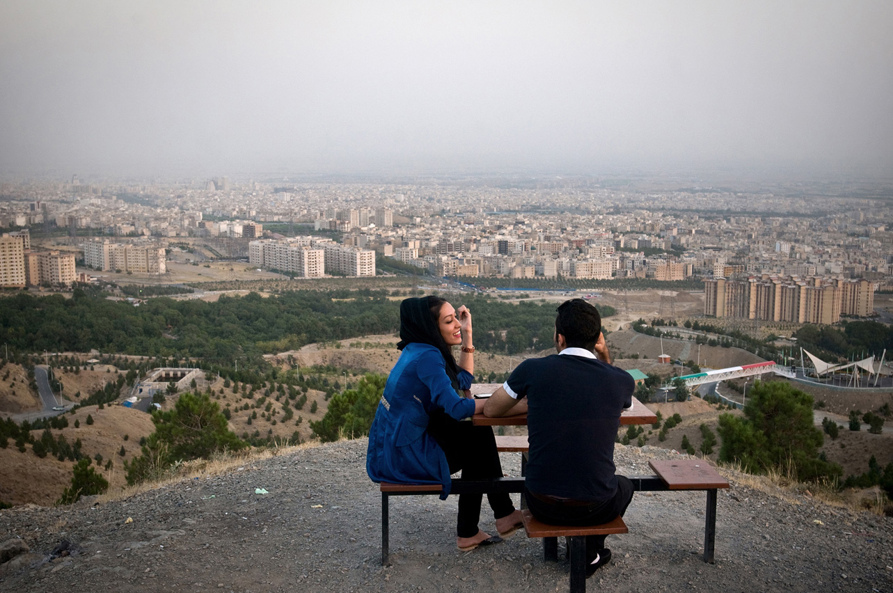 Samaneh and Shayan, a young pair rests on Kuhsar heights with a view over Tehran.