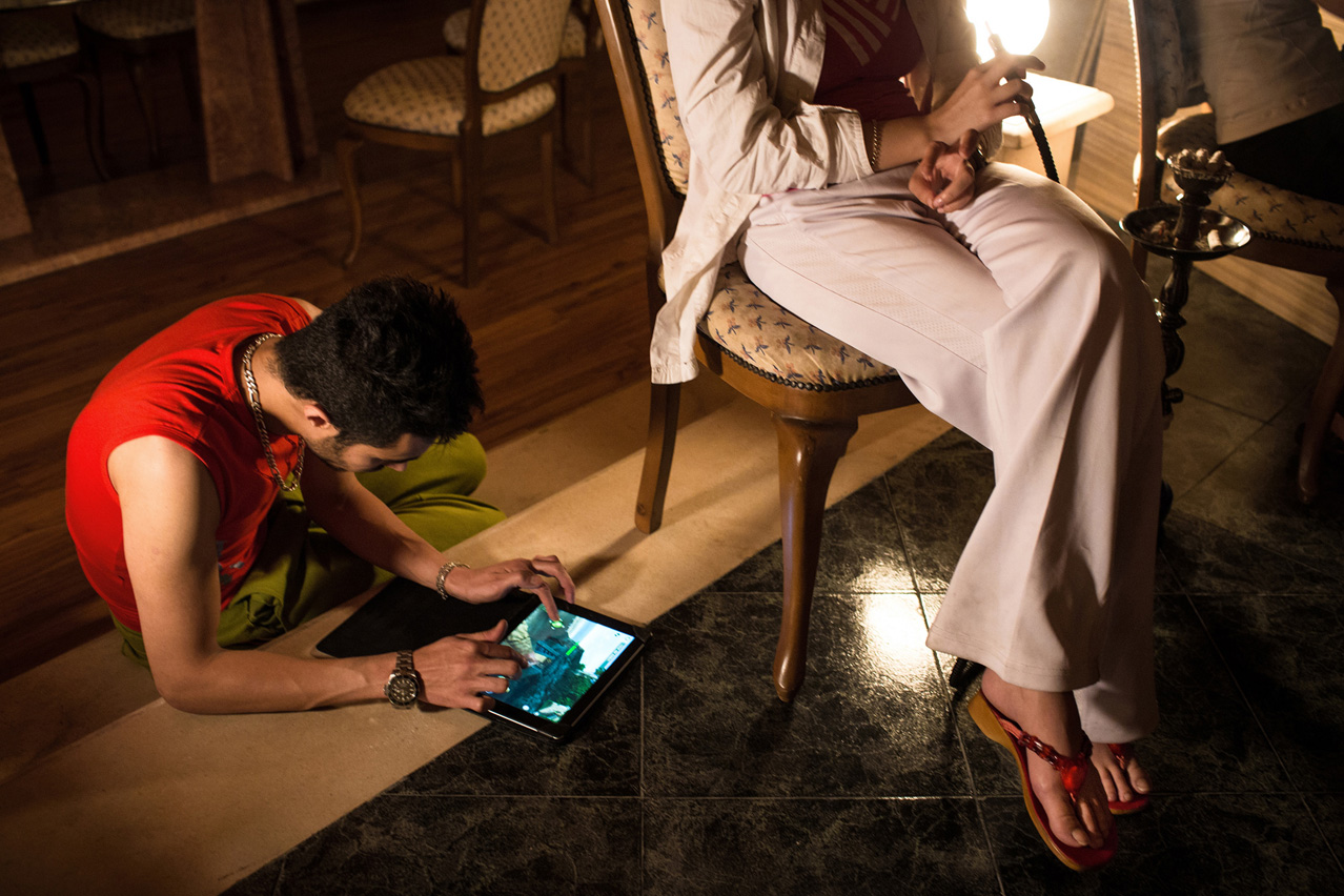 A pair during a private party over a weekend in Northern Iran. Hightech gadgets find their way to the country through Dubai despite the economic sanctions.