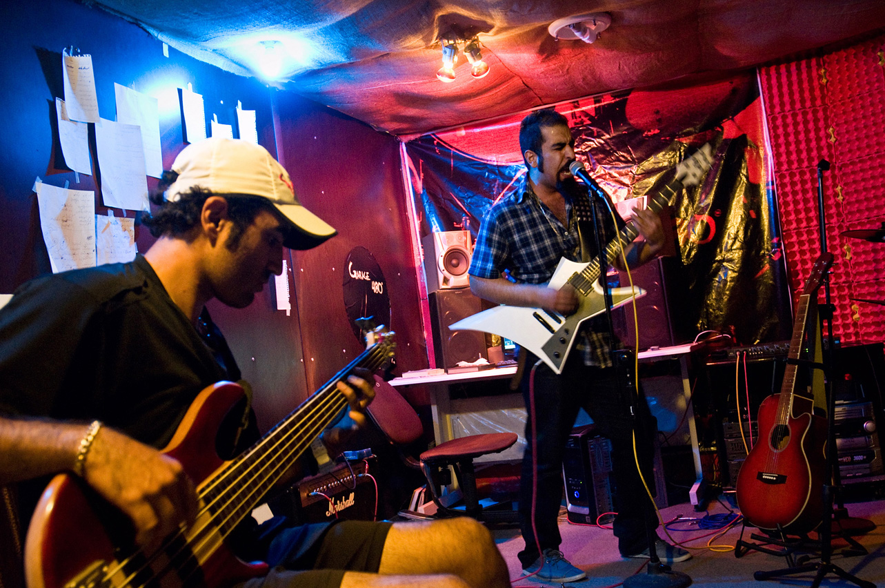 "The underground band ""Garage480"" performs a training session in a basement in Isfahan."