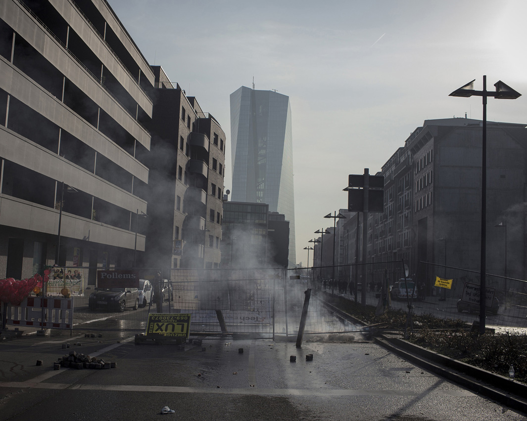 "The new headquarters of the European Central Bank is seen in the background of a road barricaded by violent demonstrators. Protests against the inauguration of the new European Central Bank (ECB) building escalated quickly in the early morning through far left ""black block""."