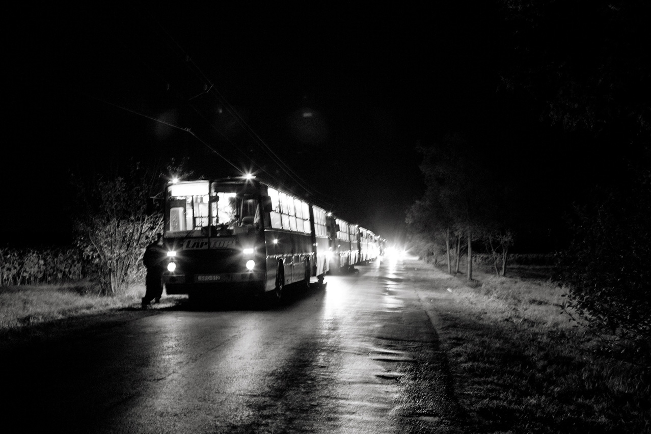 Busses carrying refugees arrived in Hungary from Serbia on September 14th, 2015 wait for a train to - assumingly - take them to the Austrian border. Many people had to stay in the buses for over six hours.