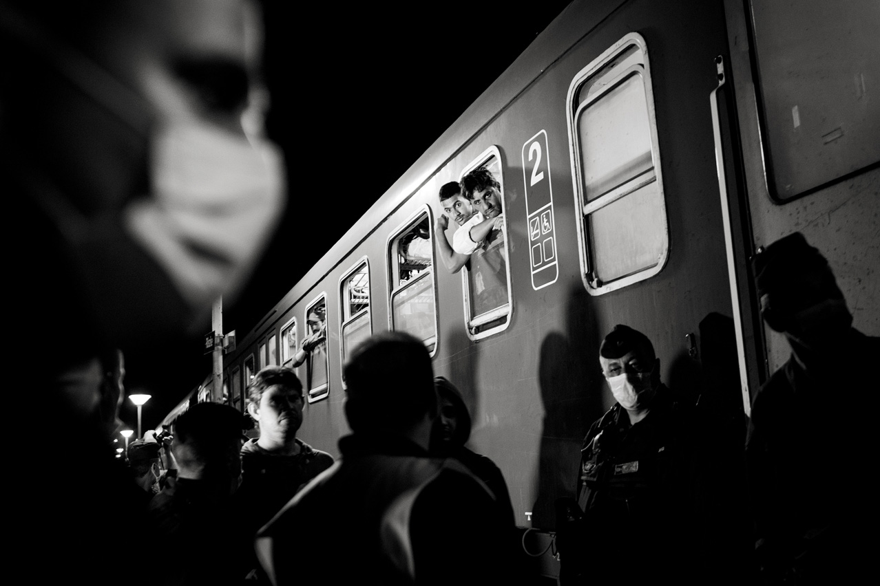 Refugees arrived in Hungary from Serbia on September 14, 2015 wait for a train to - assumingly - take them to the Austrian border.