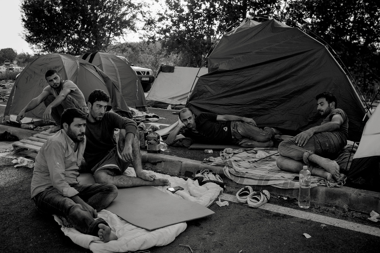 A group of Kurdish refugees rests at dust at their tents at the Horgos-Roeszke border crossing which is announced to remain closed for 30 days, since they are yet undecided how to proceed their journey. They arrive in Croatian Tovarnik two days later.
