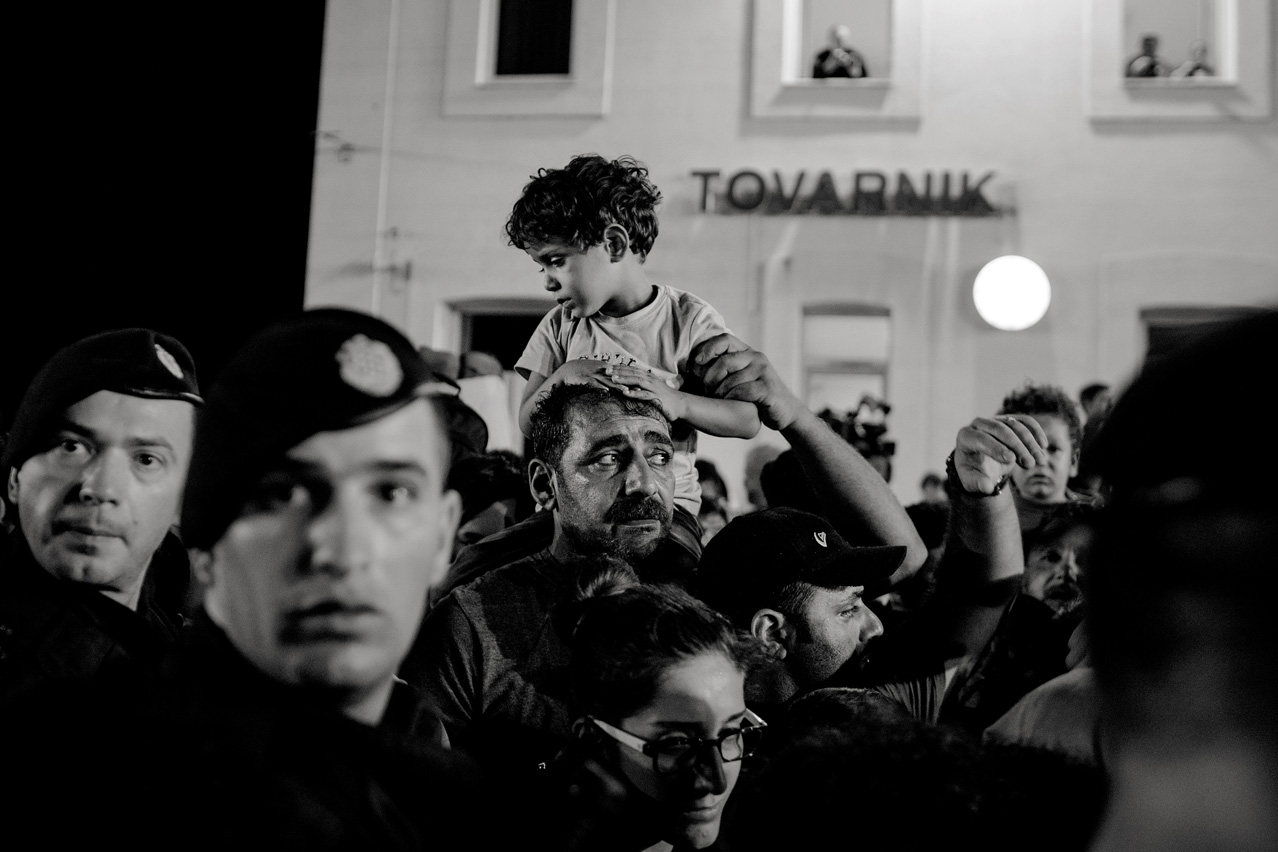 Police forces and refugees stranded in Croatia and waiting in Tovarnik train station for their turn to board a train to - assumingly - take them to Zagreb in order to be transferred through Slovenia, just realize the only train which passed this day is full and hence they have to wait at least one more day at the same place.