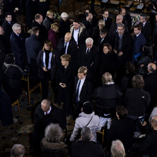 20122016, Berlin, Germany. Berlin's mayor Michael Mueller is followed members of the federal cabinet amongst others out of the church. A day after the lorry attack on the Christmas market at Breitscheidplatz, top politicians, diplomats and religious leaders paid tribute to the victims during a ceremonial act at the Kaiser Wilhelm Memorial Church. Photo: Kaveh Rostamkhani