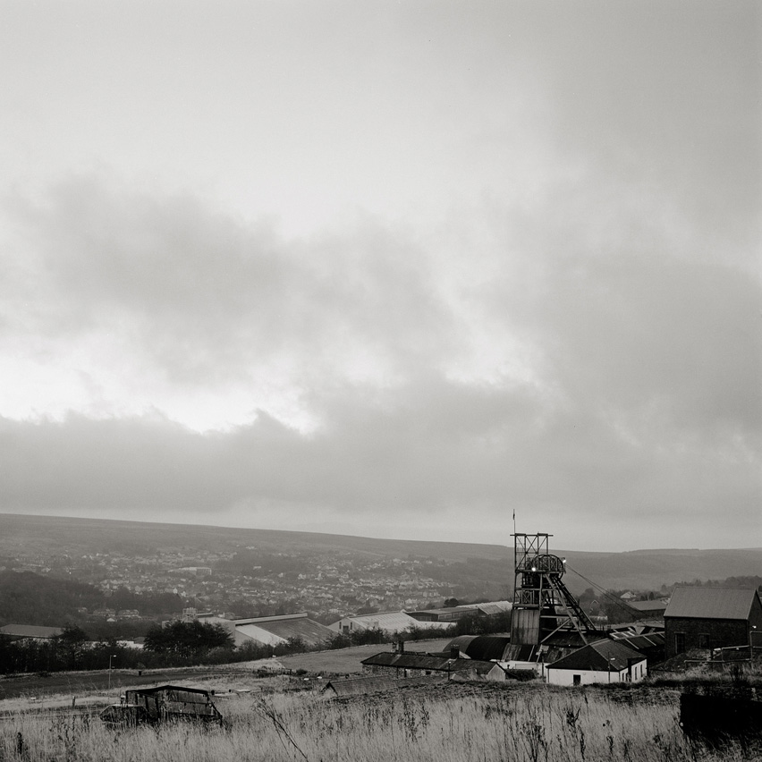 "The winding mill marks the former colliery ""Big Pit"" which is now being used as the National Coal Mining Museum in Bleanavon, Wales."