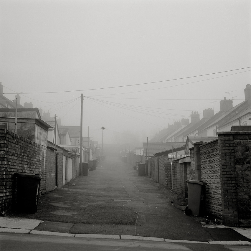View into a foggy street featuring terraced houses in Bleanavon, Wales. Once a mining hub in South Wales, now a negligible community.
