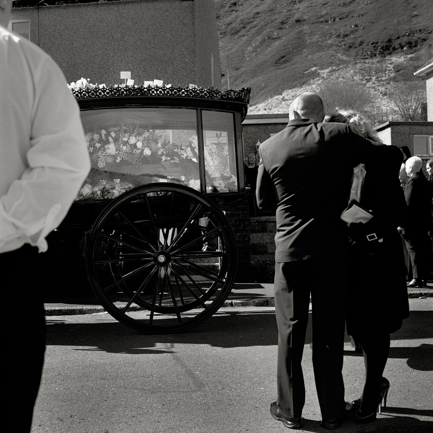 "Family members of the former miner Joseph ""Glamo"" Evans, mourn while his funeral procession starts in Maerdy, Rhondda Valleys."