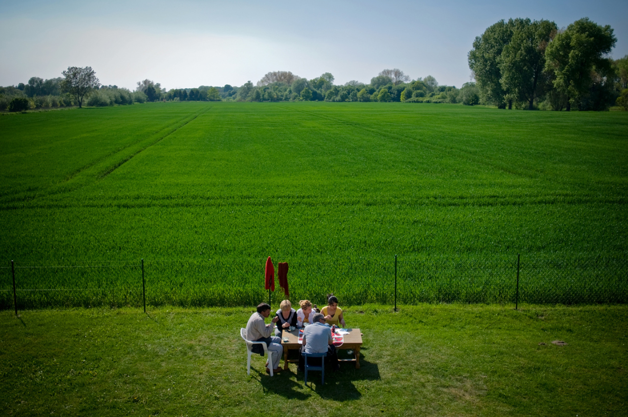 "2010. A group of asylum seekers are having a ""picnic"" in the yard of the central accomodation facility of Meinersen in Northern Germany."