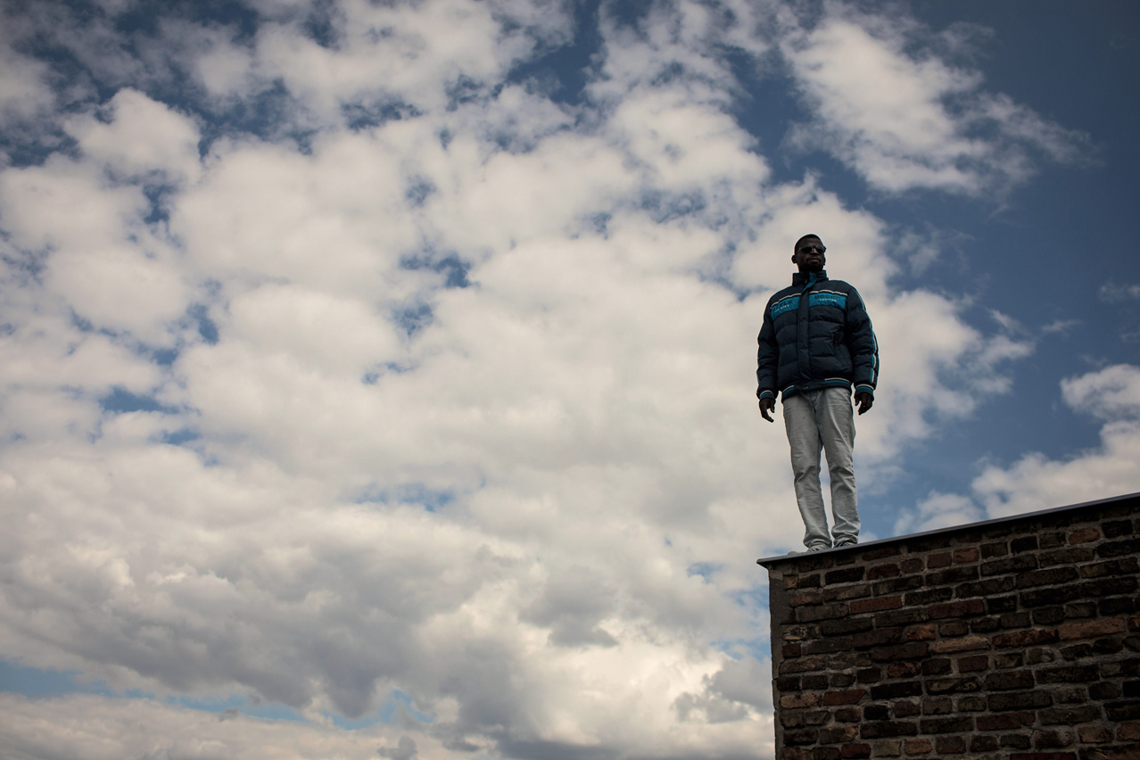 2014. Yakoub, a refugee from Sudan stands on the roof of the Gerhart Hauptmann school in Berlin's Ohlauer Street which has been squatted by refugees and their supporters.