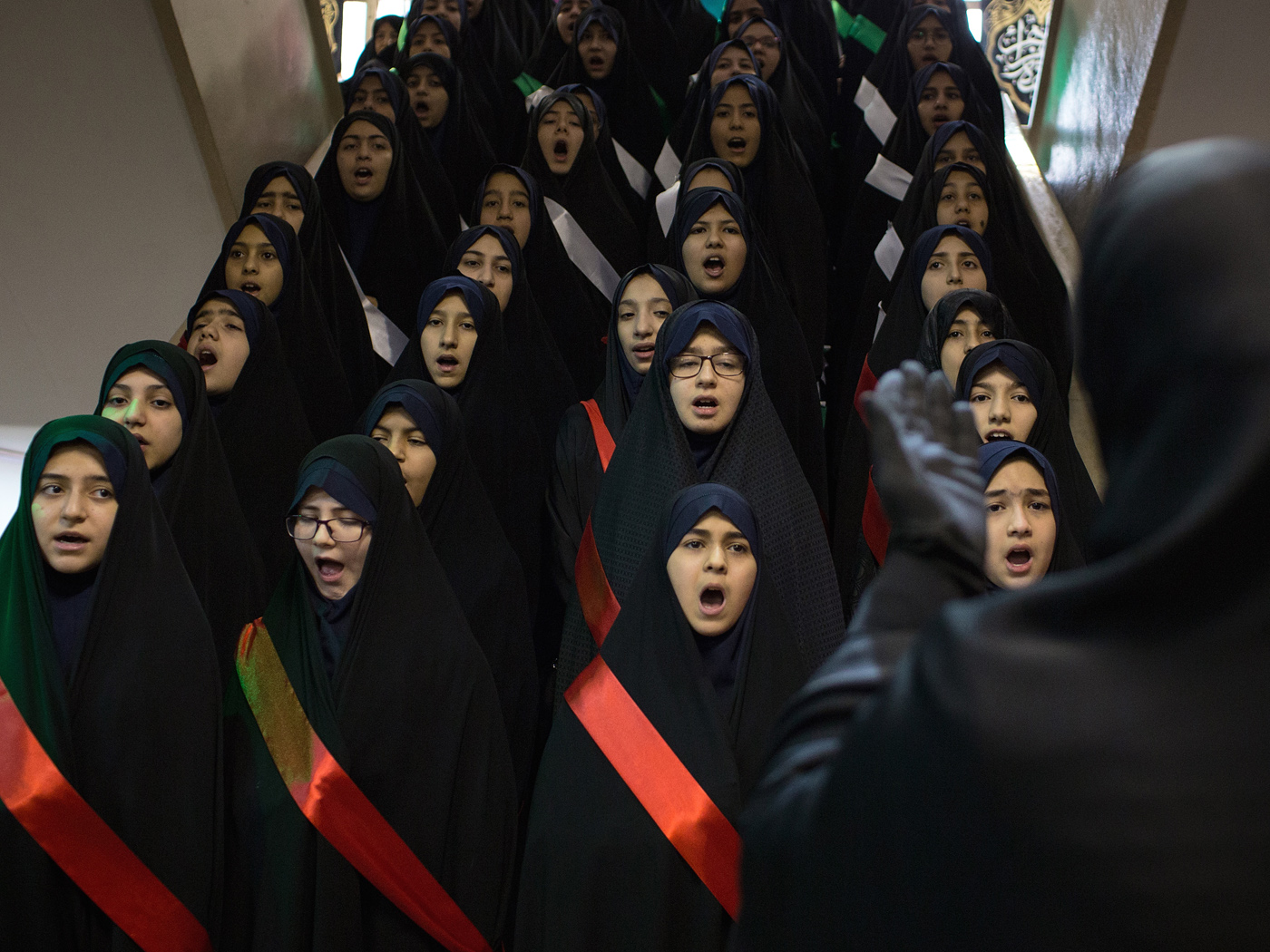 6th graders of Refah girls' elementary school in Tehran sing anthems from the Iran-Iraq War in choir on Saturday, February 2nd, 2019 as a part of an event commemorating the arrival of Ayatollah Khomeini to this school upon his return from French exile exactly 40 years earlier during the 1979 Revolution.