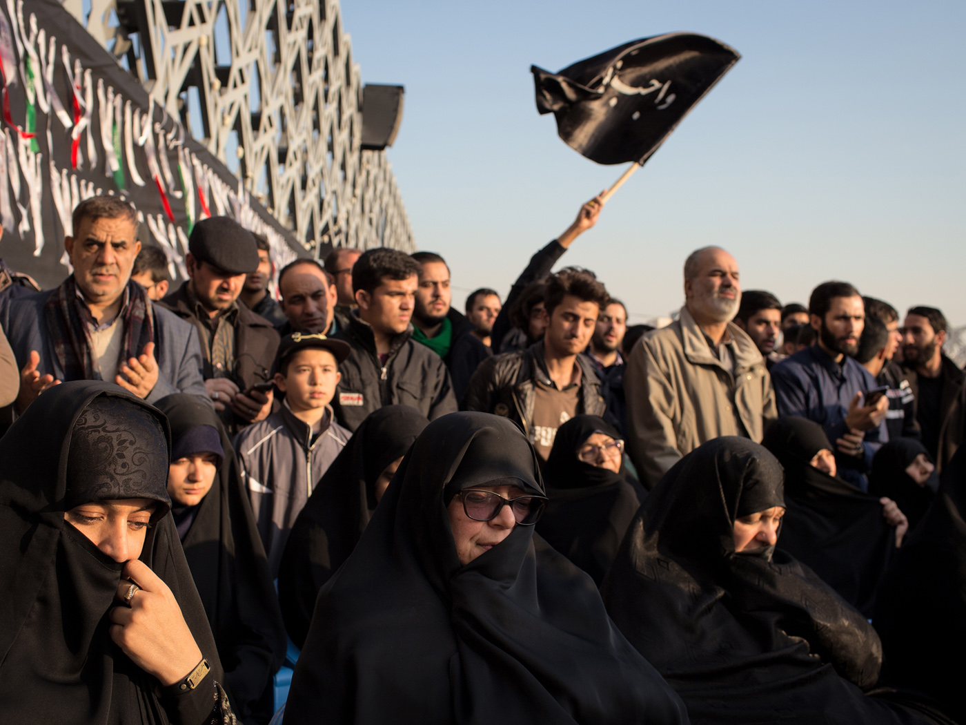 "Mother (wearing sunglasses) of Mohsen Hojjaji who was beheaded by IS in Syria sits among mothers of more famous martyrs in a front row as some thousand supporters of the Islamic Republic came together in Tehran for a ceremony branded as ""Daughters of the Revolution"" on January 31st, 2019 setting off a series of arranged events marking the 40th anniversary of the 1979 Revolution."