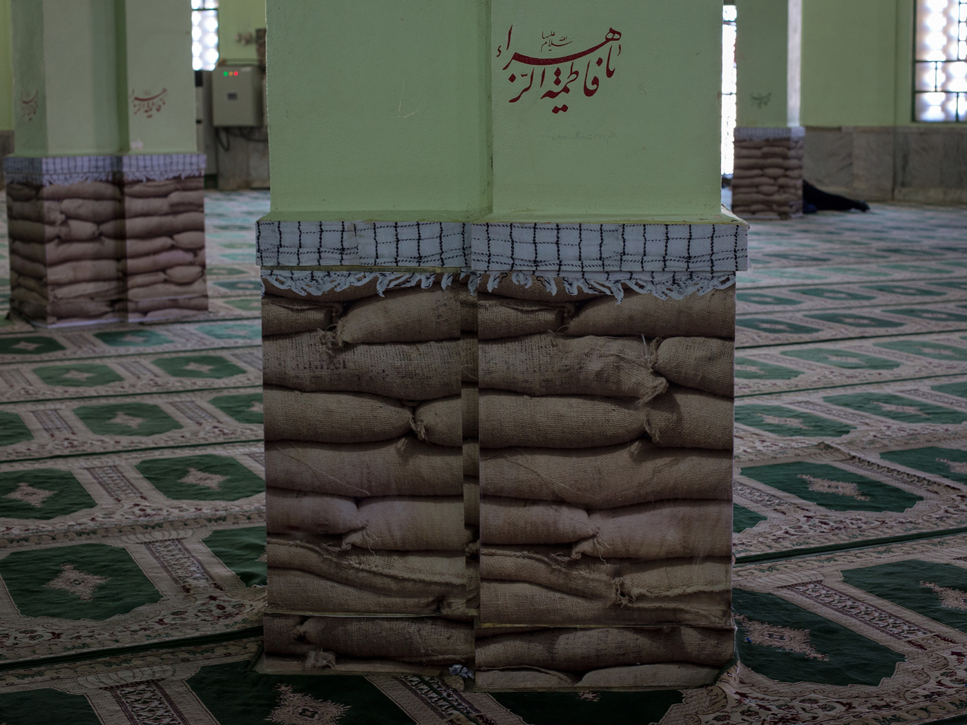 Decoration of pillars at a memorial mosque depict sand sacks which were used to protect trenches reminding of the Iran-Iraq war.