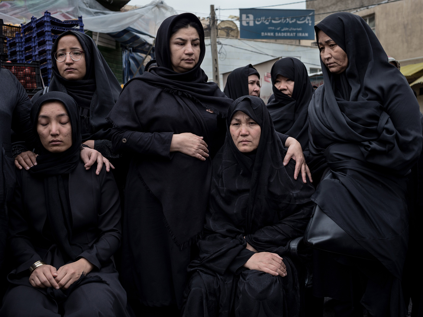 Female relatives of Alireza Akbari of the Fatemioun brigade mourn prior to the release of his corpse in the Fallah neighbourhood of Tehran on Thursday April 18th, 2019.