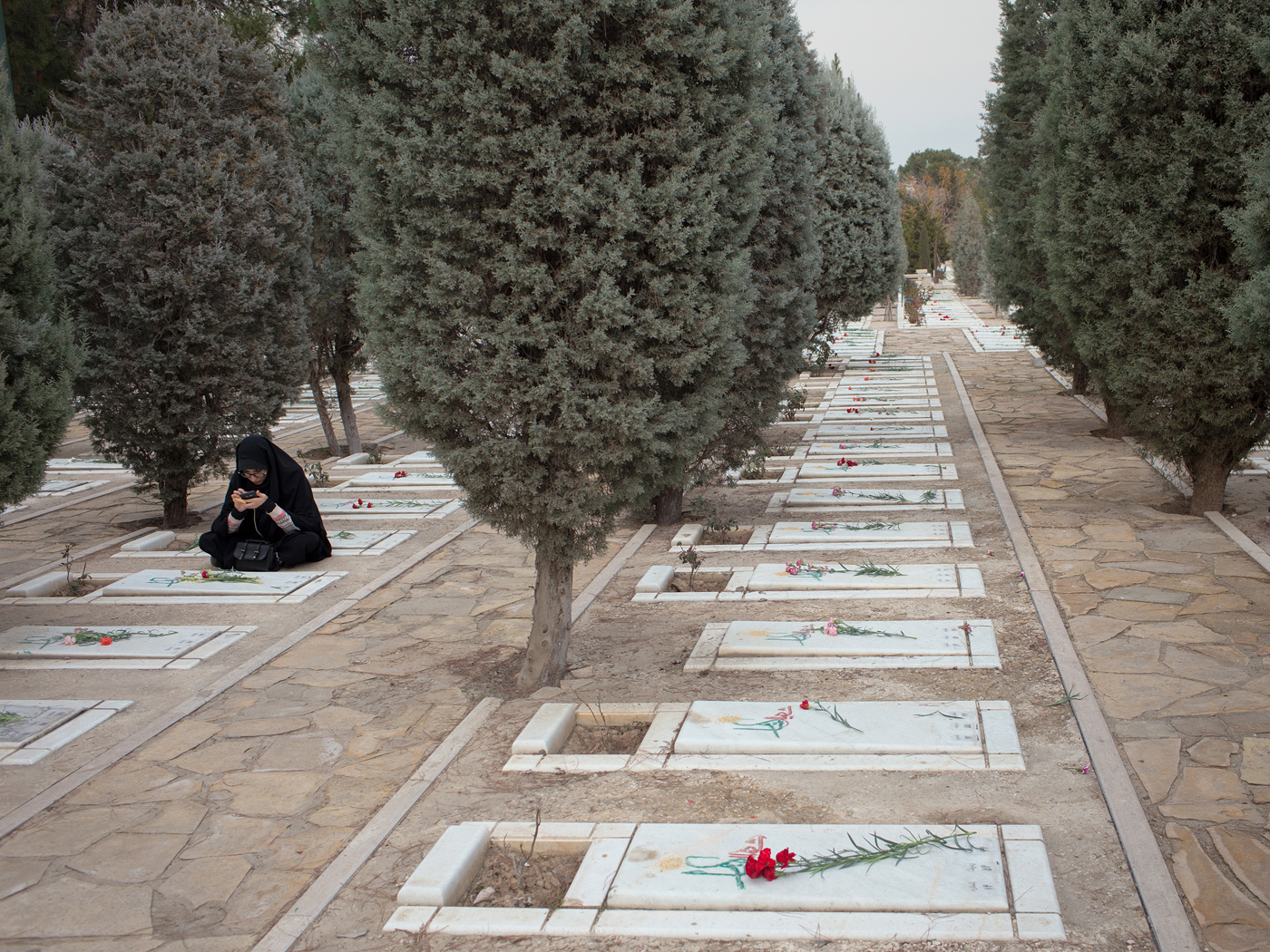 A visitor spends time at the graveyard of unkown martyrs' in Tehran's central cemetery (Behesht-e Zahra).