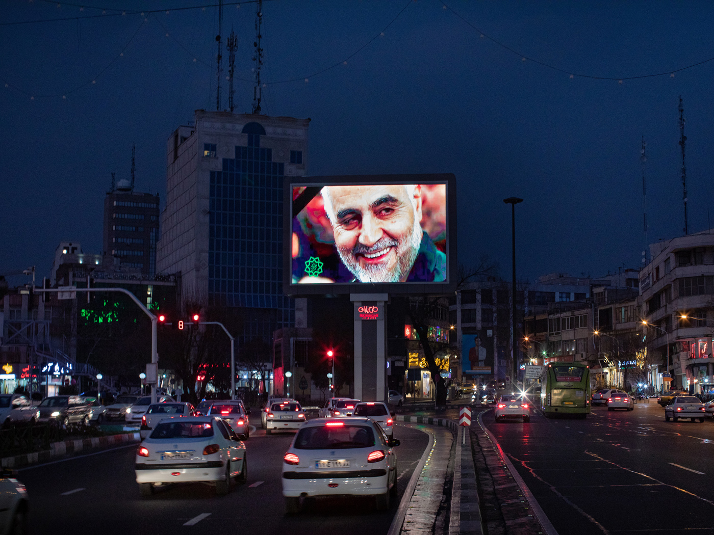 A giant digital billboard in Haft-e Tir square in central Tehran runs a picture of assassinated Revolutionary Guards Major General Qassim Suleimani as the evening traffic unfolds. Following the US-led assassination of the Al-Quds brigade commander through a drone strike in Iraq the prior night, the Supreme Leader of the Islamic Republic of Iran, Ayatollah Ali Khamenei declared three days of public mourning.